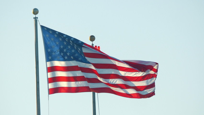 United States flag waving in New York in 4K slow motion 60fps   Shutterstock HD Video #1065994735