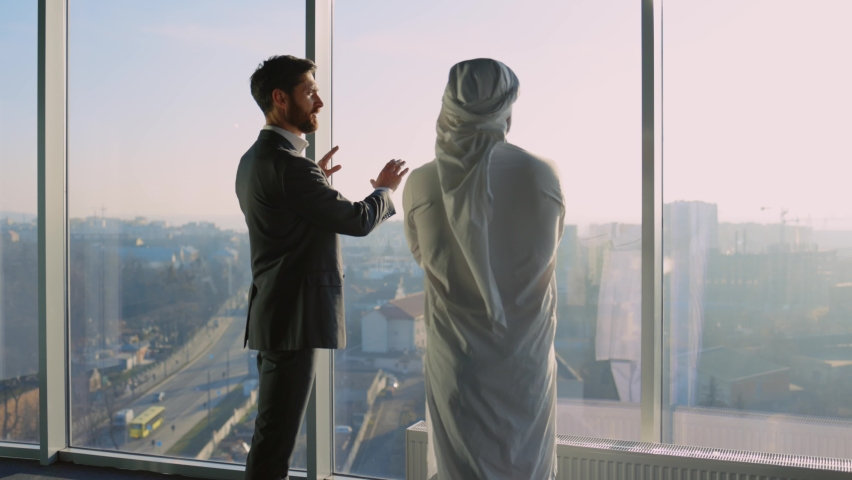 Diverse Biusiness Couple of Arab Rich Businessman Talking with Office Manager Shaking Hands Discussing Agreement for Investment. Muslim Investor. Cooperation. Royalty-Free Stock Footage #1065995596