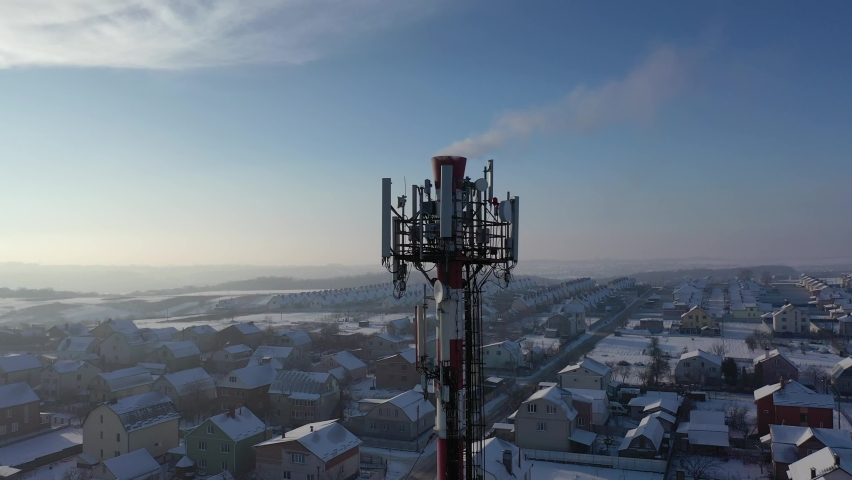 Telecommunication tower of 4G and 5G cellular. Base Station or Base Transceiver Station. Wireless Communication Antenna Transmitter. Telecommunication tower with antennas against blue sky. | Shutterstock HD Video #1066031617