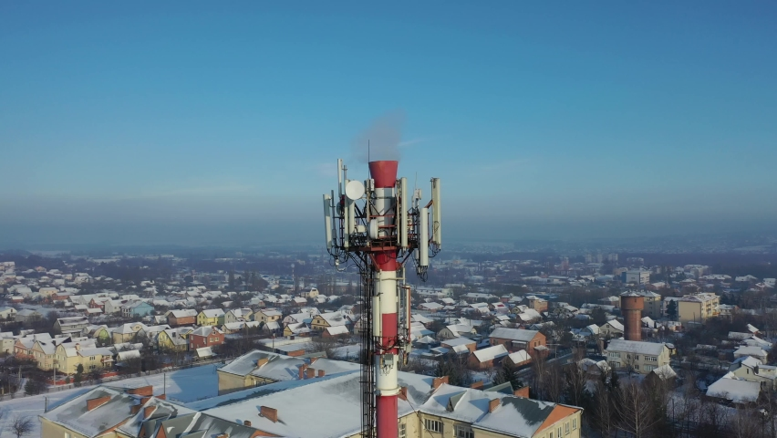 Telecommunication tower of 4G and 5G cellular. Base Station or Base Transceiver Station. Wireless Communication Antenna Transmitter. Telecommunication tower with antennas against blue sky. | Shutterstock HD Video #1066031620