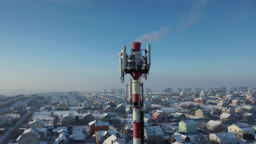 Telecommunication tower of 4G and 5G cellular. Base Station or Base Transceiver Station. Wireless Communication Antenna Transmitter. Telecommunication tower with antennas against blue sky. | Shutterstock HD Video #1066031623