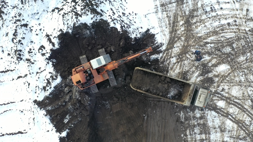 Aerial top view on crawler excavator digging ground for overhaul road. Construction machinery performs energy intensive heavy work on project | Shutterstock HD Video #1066031953