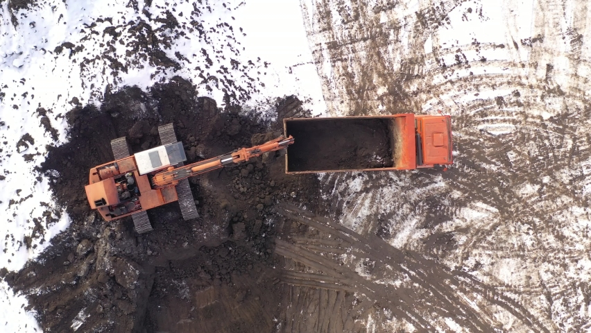 Aerial top view on crawler excavator digging ground for overhaul road. Construction machinery performs energy intensive heavy work on project | Shutterstock HD Video #1066031956