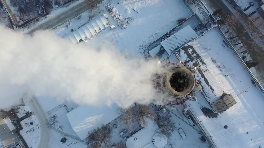 Pipes with white smoke. Pipes of a city gas boiler room with white smoke against a sky. Top view from a drone. | Shutterstock HD Video #1066032031