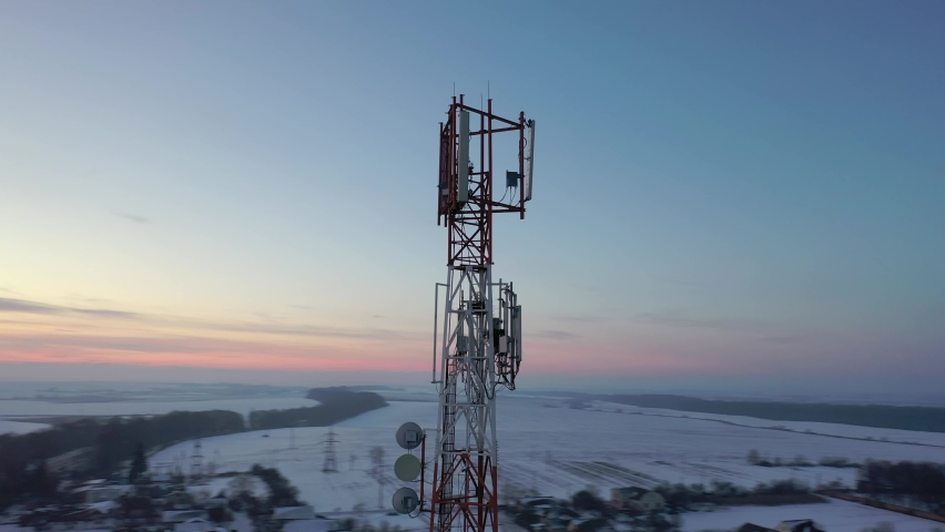 Telecommunication tower of 4G and 5G cellular. Base Station or Base Transceiver Station. Wireless Communication Antenna Transmitter. Telecommunication tower with antennas against blue sky. | Shutterstock HD Video #1066032103