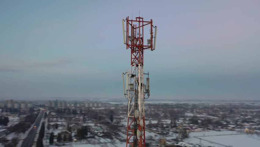 Telecommunication tower of 4G and 5G cellular. Base Station or Base Transceiver Station. Wireless Communication Antenna Transmitter. Telecommunication tower with antennas against blue sky. | Shutterstock HD Video #1066032106