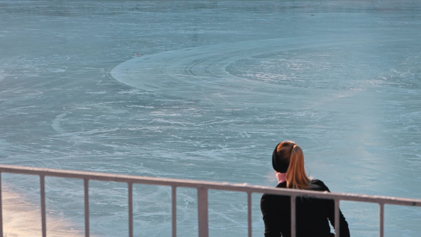 Young woman training her figure skating outdoors | Shutterstock HD Video #1066032586