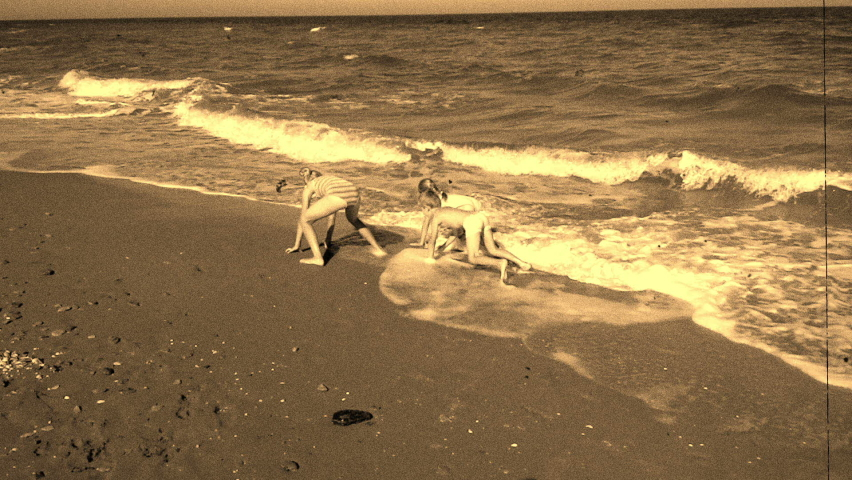 3 children on the beach playing with sea waves Royalty-Free Stock Footage #1066033003