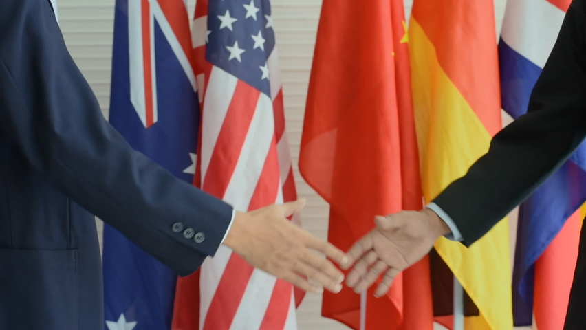 Two people handshake and background with flag  | Shutterstock HD Video #1066033006