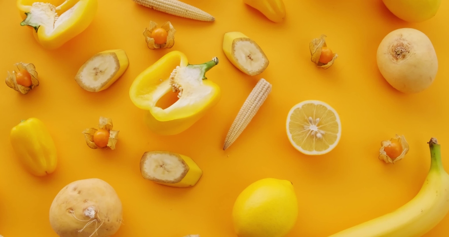 Fruits and vegetables on a yellow background | Shutterstock HD Video #1066033813