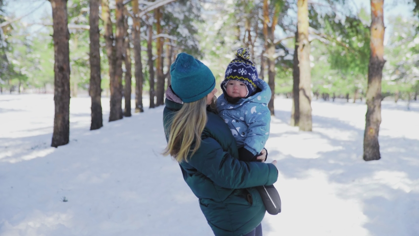 Young mother with little kid posing on the camera | Shutterstock HD Video #1066052212