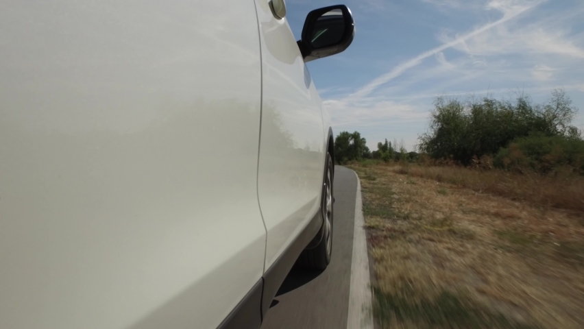 4K close-up car driving on rural road, pov view wheel spinning, nature landscape | Shutterstock HD Video #1066053346