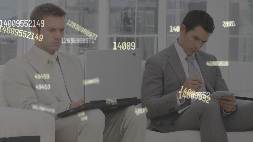 Multiple changing numbers floating against two business using laptop and taking notes. computer interface and business technology concept. | Shutterstock HD Video #1066054225