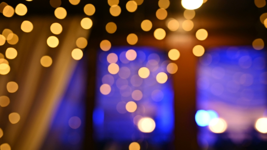 Lamps close up. Wedding garlands that glow near the restaurant window. Vespers Wedding Ceremony | Shutterstock HD Video #1066055002