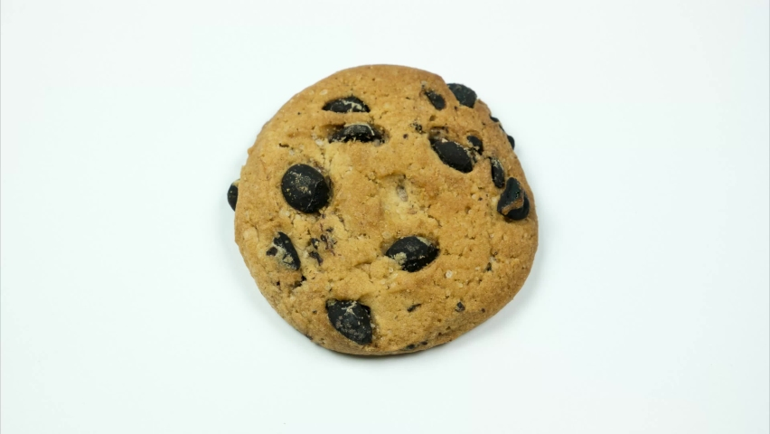 Round cookies spinning and forming background for text. Stop motion | Shutterstock HD Video #1066057006