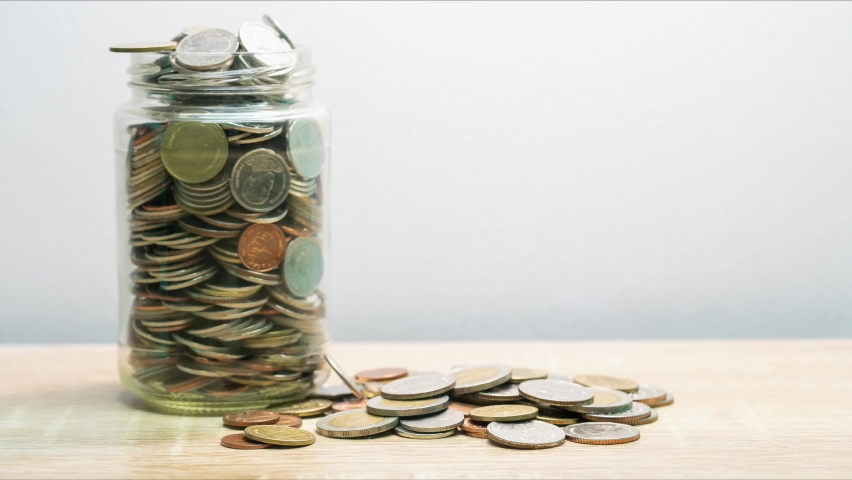 Stop motion animation coin into a clear glass jar  | Shutterstock HD Video #1066070749