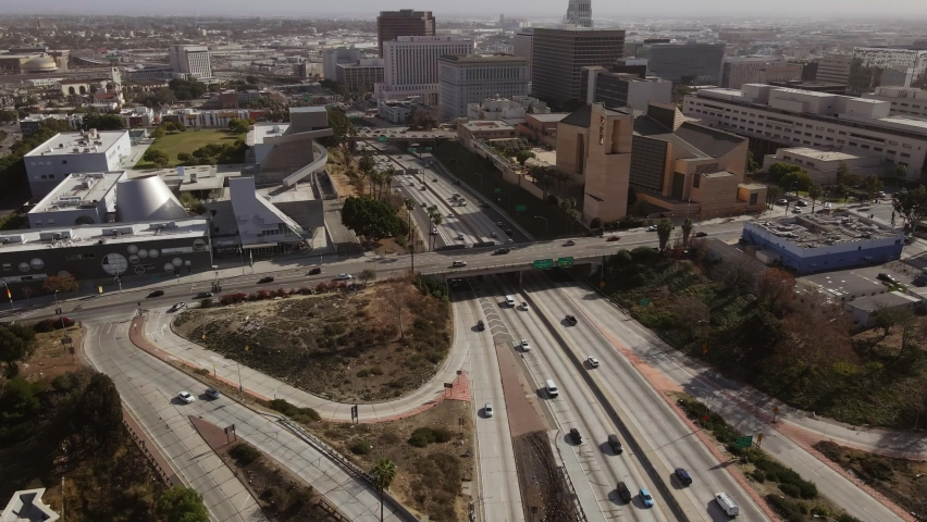 Day time drone shot reveals spectacular highway and intersection of roads, bridges in downtown Los Angeles. California | Shutterstock HD Video #1066092568