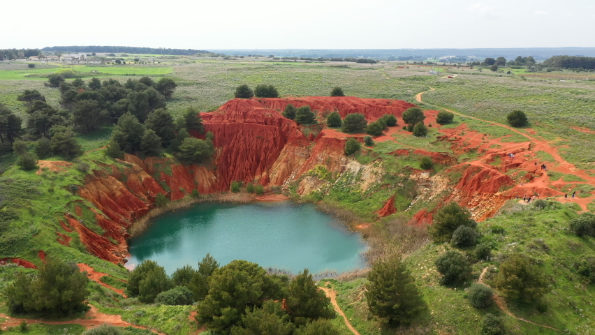 Lago di Bauxite, Italy. Fascinating natural landscape of charming Puglia region. The intense emerald color lake is the peculiarity of the Bauxite Cave of Otranto. High quality 4k footage | Shutterstock HD Video #1066093372