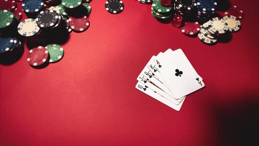 Casino. Poker. Game chips for betting in gambling. Poker chips. Royal Flush. | Shutterstock HD Video #1066117180