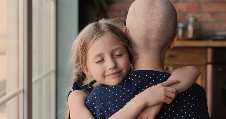 Daughter tight hug mother cancer patient show support give tenderness in hard period of rehab, mom shaved bald head close up back view. Unconditional love, life value, motivation to struggle concept
