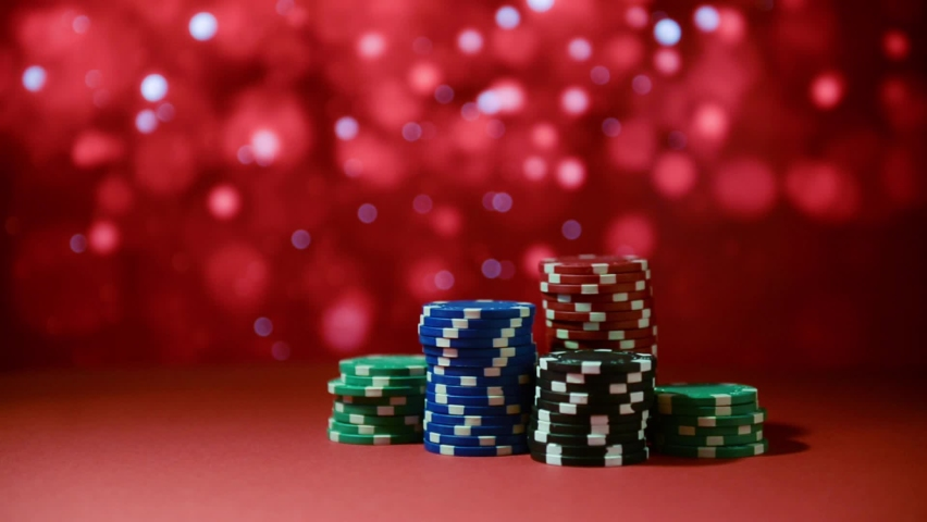 Casino. Poker. Chips for betting in gambling on a red surface on a blurred background. Poker chips. | Shutterstock HD Video #1066135732