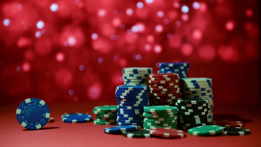 Casino. Poker. Chips for betting in gambling on a red surface on a blurred background. Poker chips. | Shutterstock HD Video #1066135735