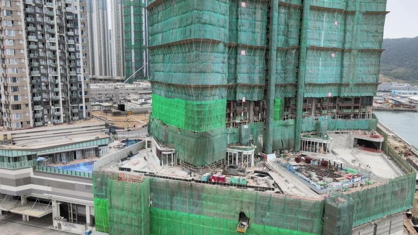 Large-scale commercial and residential construction site works Cranes Foundation works in Lohas Park, Tseung Kwan O of Hong Kong city, Kowloon Aerial Top view | Shutterstock HD Video #1066141348