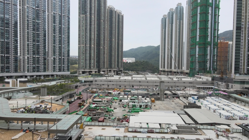 Large-scale commercial and residential construction site works Cranes Foundation works in Lohas Park, Tseung Kwan O of Hong Kong city, Kowloon Aerial Top view | Shutterstock HD Video #1066141351