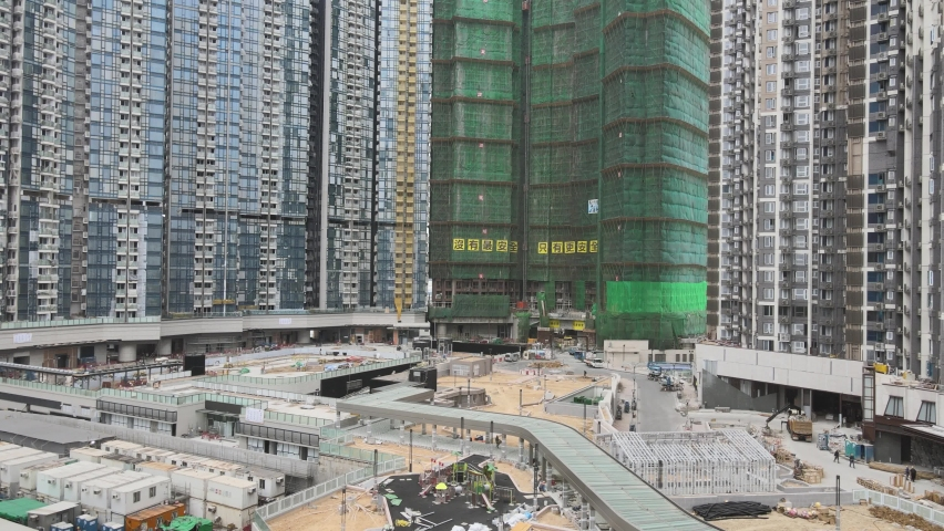 Large-scale commercial and residential construction site works Cranes Foundation works in Lohas Park, Tseung Kwan O of Hong Kong city, Kowloon Aerial Top view | Shutterstock HD Video #1066141354