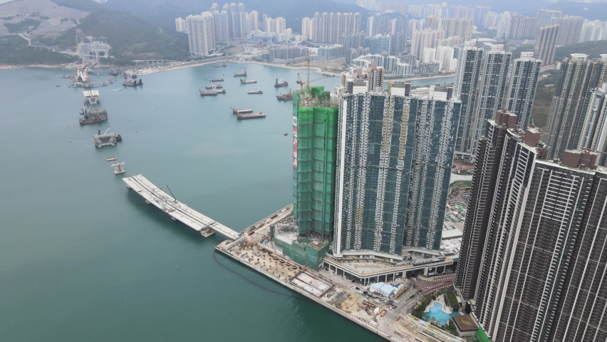 Large-scale commercial and residential construction site works Cranes Foundation works in Lohas Park, Tseung Kwan O of Hong Kong city, Kowloon Aerial Top view | Shutterstock HD Video #1066141357
