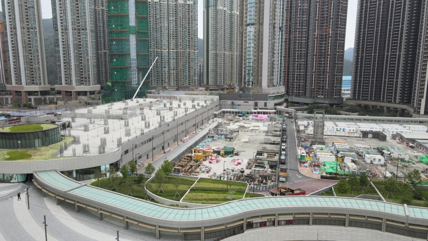 Large-scale commercial and residential construction site works Cranes Foundation works in Lohas Park, Tseung Kwan O of Hong Kong city, Kowloon Aerial Top view | Shutterstock HD Video #1066141360