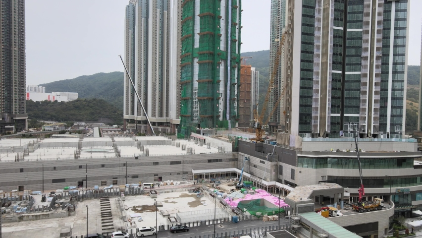 Large-scale commercial and residential construction site works Cranes Foundation works in Lohas Park, Tseung Kwan O of Hong Kong city, Kowloon Aerial Top view | Shutterstock HD Video #1066141366