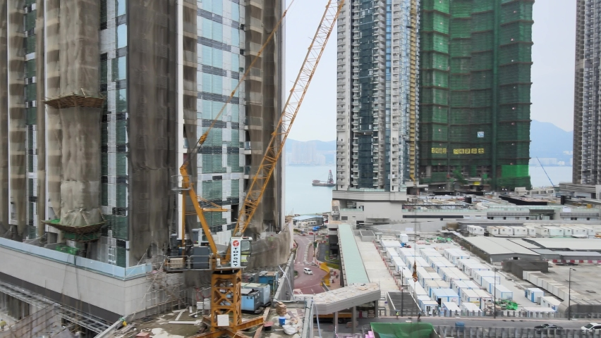Large-scale commercial and residential construction site works Cranes Foundation works in Lohas Park, Tseung Kwan O of Hong Kong city, Kowloon Aerial Top view | Shutterstock HD Video #1066141369