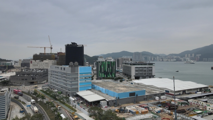 Large-scale commercial and residential construction site works Cranes Foundation works in Lohas Park, Tseung Kwan O of Hong Kong city, Kowloon Aerial Top view | Shutterstock HD Video #1066141381