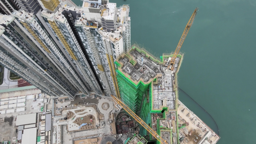 Large-scale commercial and residential construction site works Cranes Foundation works in Lohas Park, Tseung Kwan O of Hong Kong city, Kowloon Aerial Top view | Shutterstock HD Video #1066141393
