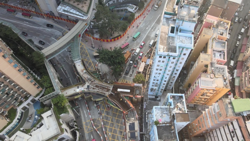 Large-scale commercial and residential construction site works Cranes Foundation works in Lohas Park, Tseung Kwan O of Hong Kong city, Kowloon Aerial Top view | Shutterstock HD Video #1066141396