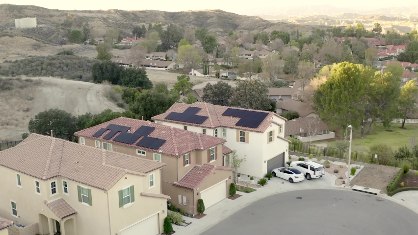 Aerial shot of solar panels and electric car, futuristic modern California home | Shutterstock HD Video #1066154560