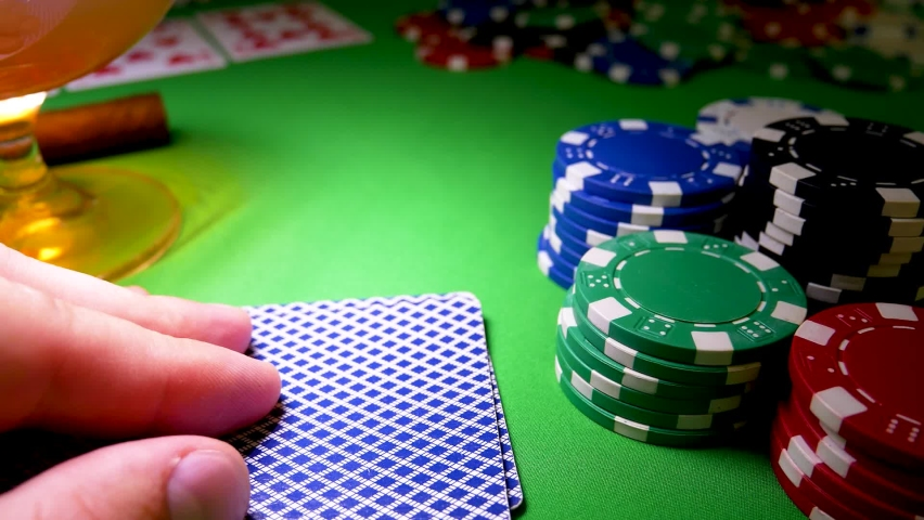Two Ace card of hearts in hand in poker game. Poker card on green table. Successful gambler's fingers in casino games. Las Vegas area concept. Gambling chip | Shutterstock HD Video #1066161571