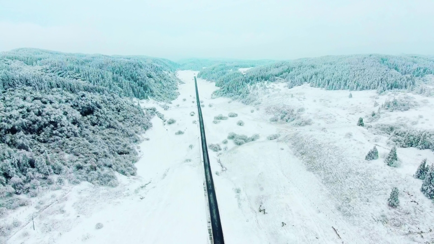 Aerial view of Xiannv Mountain Road after winter snow in Chongqing of China | Shutterstock HD Video #1066172746