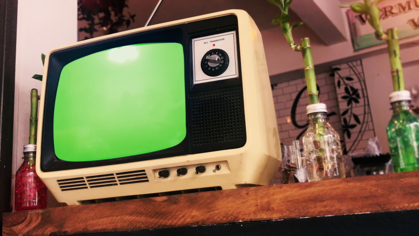 Old Vintage TV with Green Screen on the Shelf. Zoom In. 4K Resolution.   Shutterstock HD Video #1066176598