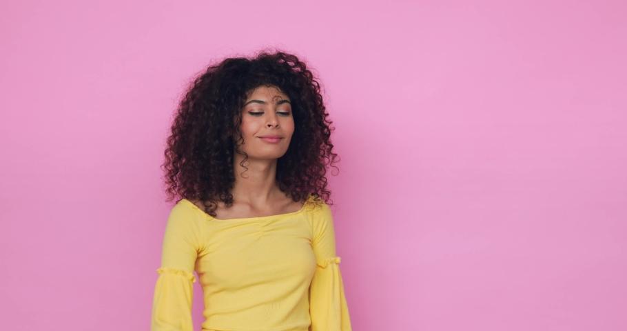 Curly young woman taking selfie and using smartphone isolated on pink | Shutterstock HD Video #1066184614