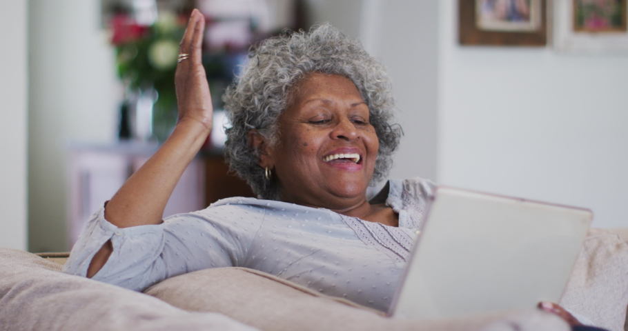 Senior african american woman waving and blowing kisses while having a video call on digital tablet at home. staying at home in self isolation in quarantine lockdown | Shutterstock HD Video #1066188016