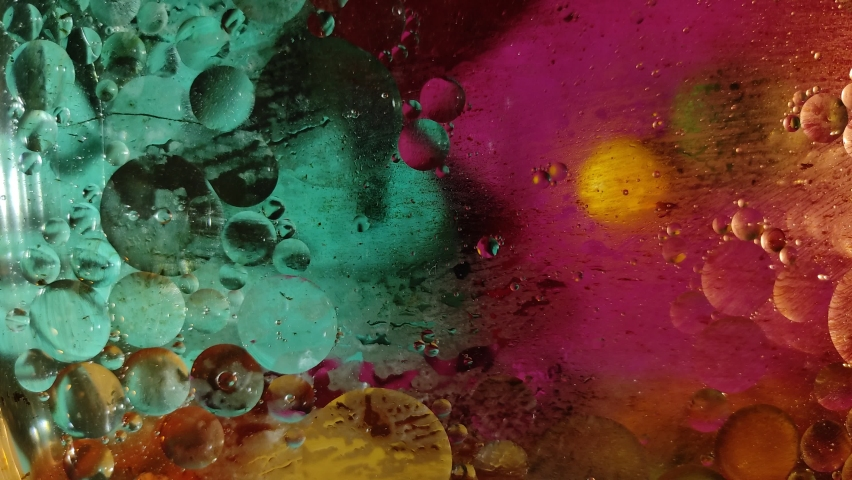 Chaotically moving multicolored bubbles in a viscous liquid substance.  | Shutterstock HD Video #1066212268