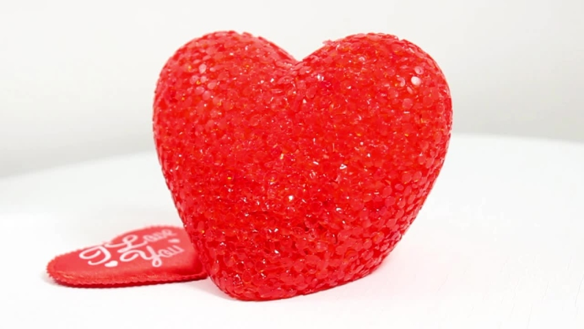 Two red decorative hearts with the inscription I love you. The concept of the Valentine's Day holiday. Selective shot. | Shutterstock HD Video #1066225588