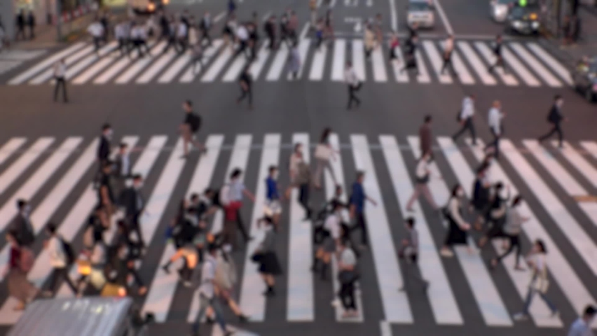 TOKYO, JAPAN : Aerial high angle view of crowd of people walking at zebra crossing in rush hour. Commuters at the street. Japanese city lifestyle, business and work concept. Slow motion blurred shot. | Shutterstock HD Video #1066236811