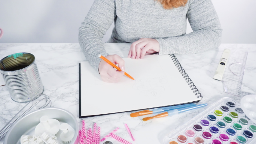 Baker is drawing the design of a birthday cake with watercolors. | Shutterstock HD Video #1066268926