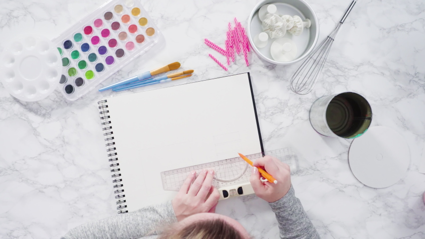 Flat lay. Baker is drawing the design of a birthday cake with watercolors. | Shutterstock HD Video #1066268935