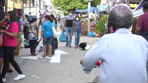 Georgetown, Penang, Malaysia - Nov 08 2020: Indian people go shopping at street. People wear avoid COVID-19