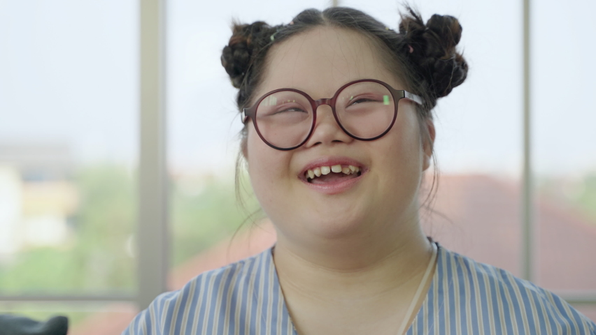 Portrait, girl with Down syndrome laughing