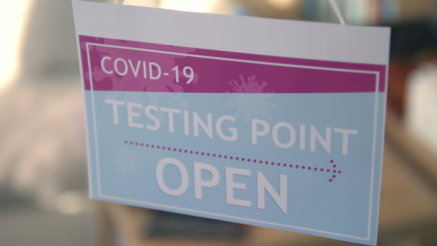 Information sign on the entrance to the Covid-19 Testing Center in 4K Slow motion 60fps | Shutterstock HD Video #1066326916
